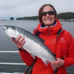guest holding up a nice coho salmon