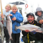 Kids holding up their fish - Sunset Charters